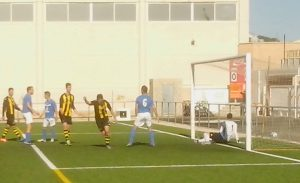 Above: Perelló's first goal. Top: One of the high balls of the first half.